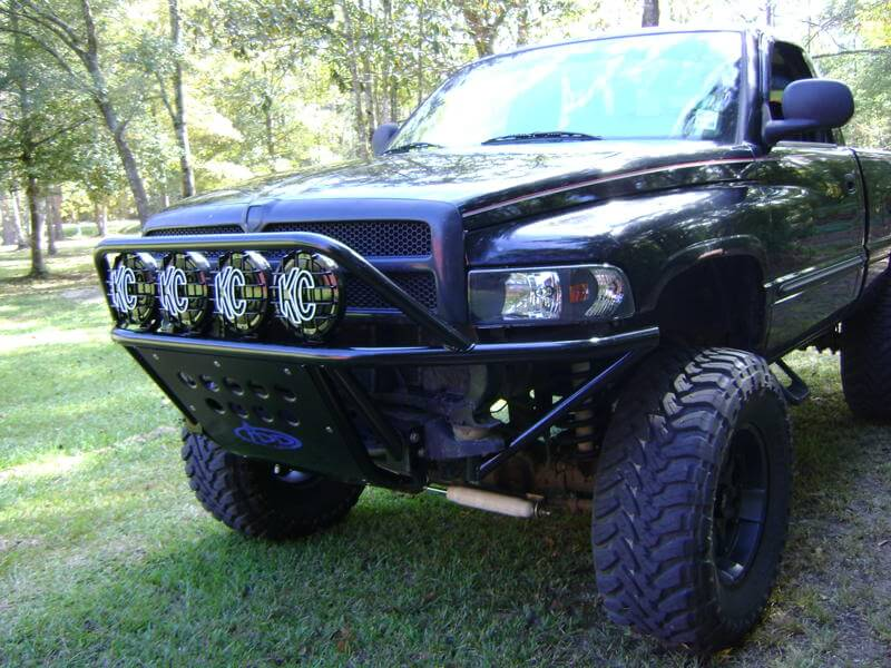 1993 - 2001 Dodge Ram 1500 Standard Front Bumper (Non Stealth) with 8 round lights  in  Hammer Black and Satin Black panels